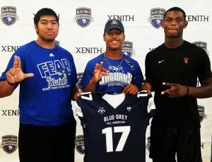 Louisville commit Poutasi Poutasi, Arizona commit Tony Fields and USC commit Randal Grimes (left to right) were acknowledged during the recent nationwide Blue-Grey Jersey Presentation Tour.