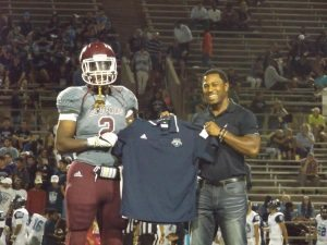 Big 12 Conference target Billy Reagins (left) was recognized by NFL veteran trainer Reggie Young (right) during the recent nationwide Blue-Grey Jersey Presentation Tour.